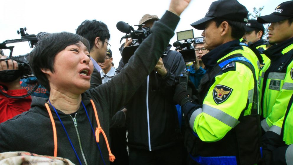 PHOTO: A weeping relative of a missing passenger aboard the sunken ferry Sewol shouts as she tries to march toward the presidential house to protest the governments rescue operation in Jindo, South Korea, Sunday, April 20, 2014.