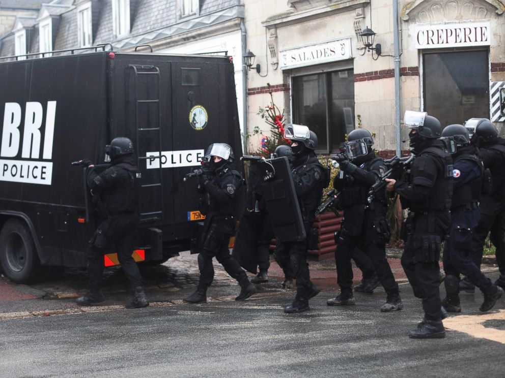 PHOTO: French riot officers patrol in Longpont, north of Paris, France, Jan. 8, 2015.