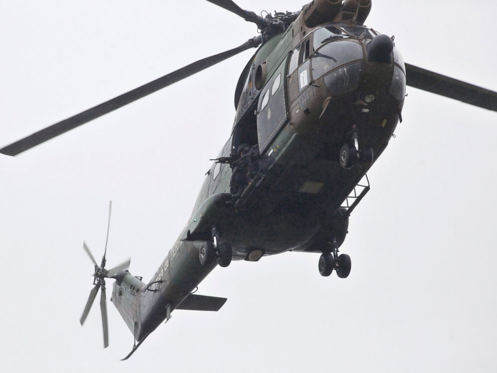 PHOTO: Armed French security forces fly over the location where two heavily armed suspects, believed to have taken part in the Charlie Hebdo shootings, are located in Dammartin-en-Goele, northeast of Paris, Jan. 9, 2015.