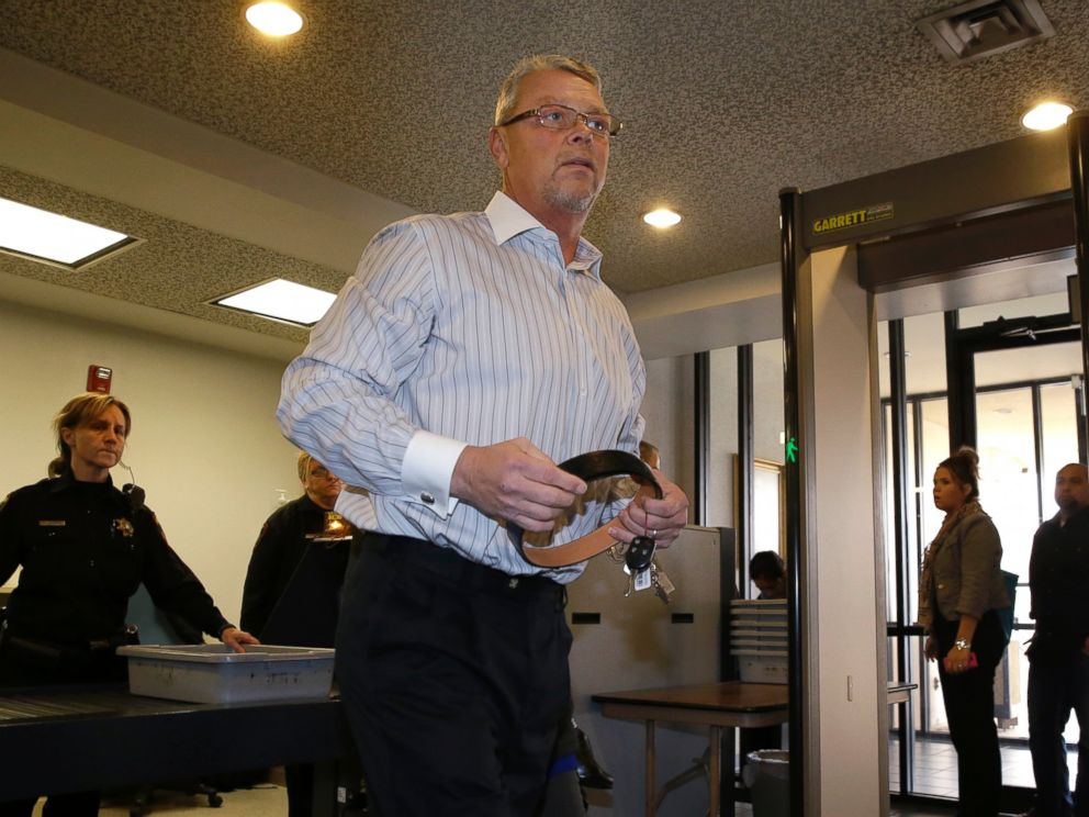 PHOTO: Fred Couch, father of affluenza teen Ethan Couch, collects his belt after clearing security as he arrives at juvenile court, Feb. 5, 2014, in Fort Worth, Texas.