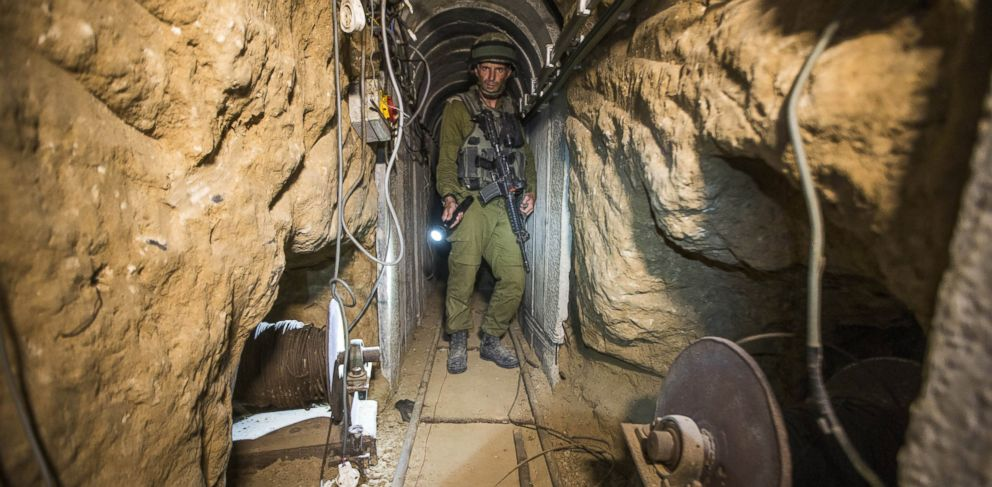 PHOTO: An Israeli army officer gives journalists a tour, Friday, July 25, 2014, of a tunnel allegedly used by Palestinian militants for cross-border attacks, at the Israel-Gaza Border.