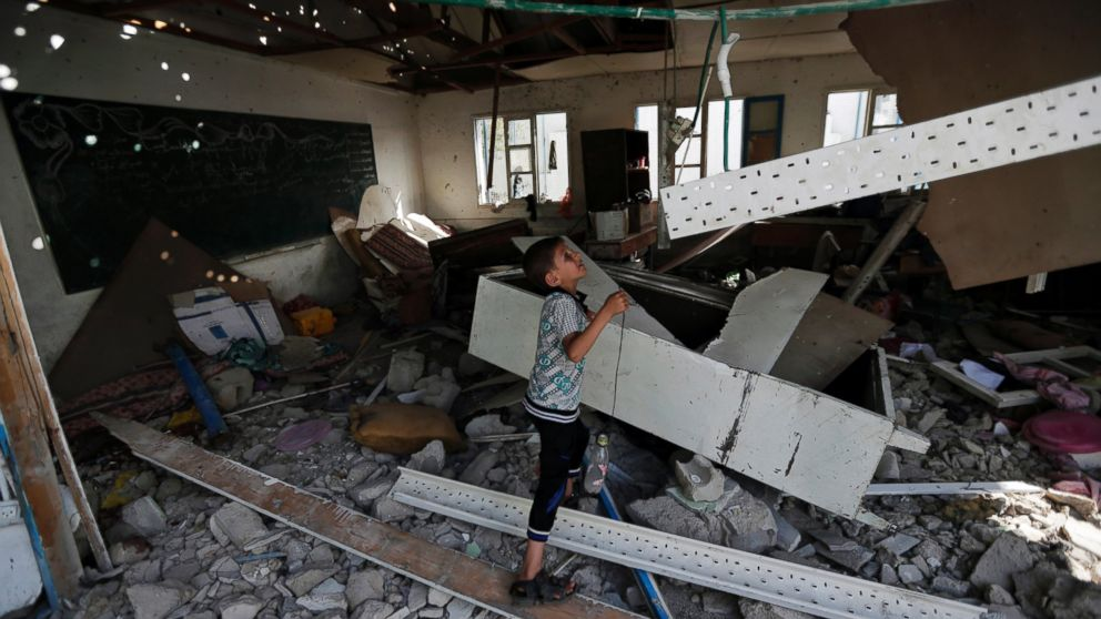 PHOTO: A displaced Palestinian child stands in a classroom at the Abu Hussein U.N. school in Jebaliya refugee camp on July 30, 2014.