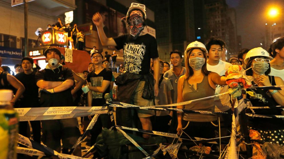 PHOTO: Pro-democracy protesters stage a rally on a occupied road in Mong Kok district, Hong Kong, Sunday, Oct. 5, 2014.