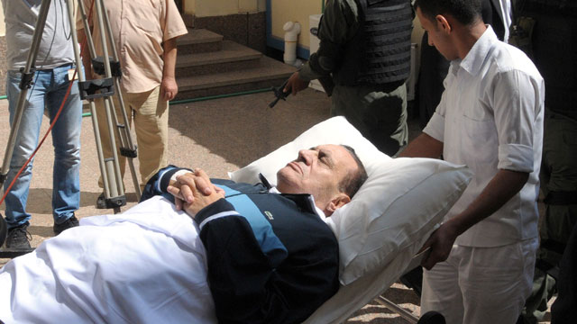 PHOTO: In this Sept. 7, 2011 file photo, former Egyptian president Hosni Mubarak  lies on his bed while being taken to the courtroom for another session of his trial in Cairo, Egypt.