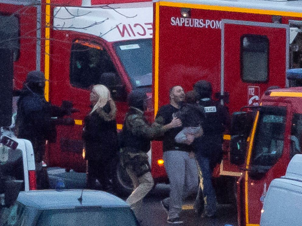 PHOTO: A security officer directs released hostages after they stormed a kosher market to end a hostage situation, Paris, Jan. 9, 2015.