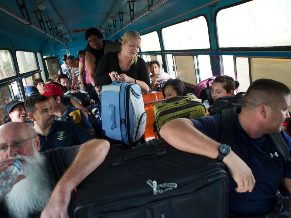PHOTO: Mexican and international tourists board a bus to be transported to a shelter, bracing for the arrival of Hurricane Patricia in Puerto Vallarta, Mexico, Oct. 23, 2015.