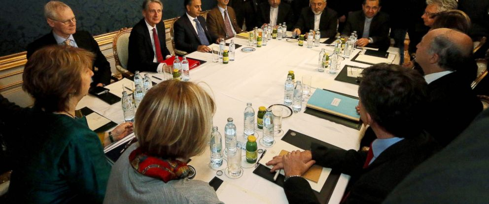 Former EU foreign policy chief Catherine Ashton, left, British Foreign Secretary Philip Hammond, third left, Iranian Foreign Minister Mohammad Javad Zarif, rear center, and French Foreign Minister Laurent Fabius, second right, wait for the start of closed