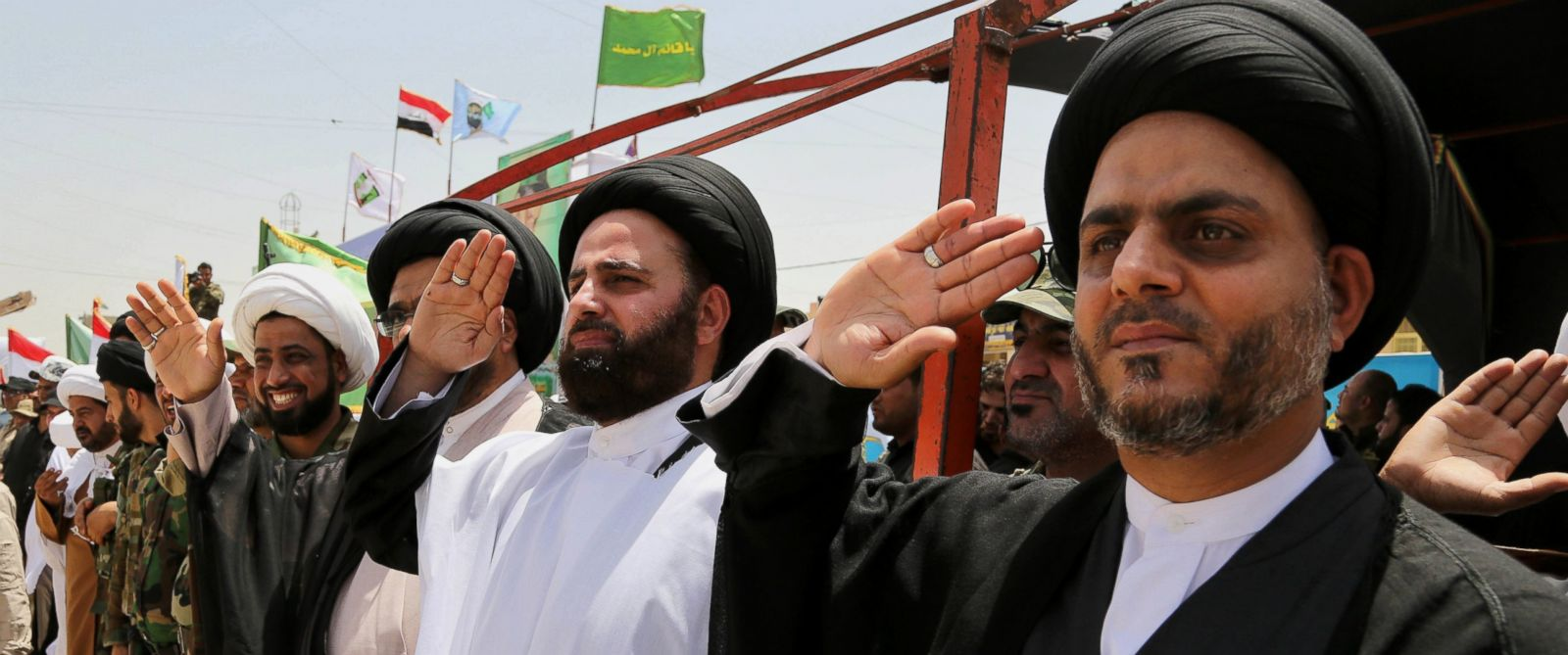 "PHOTO: Sadrist officials salute volunteers of the newly formed ""Peace Brigades"" in a parade in the Shiite stronghold of Sadr City, Baghdad, Iraq, Saturday, June 21, 2014."