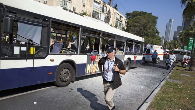 PHOTO: An Israeli security officer rushes to the site of a bombing in Tel Aviv, Israel, Wednesday, Nov. 21, 2012.
