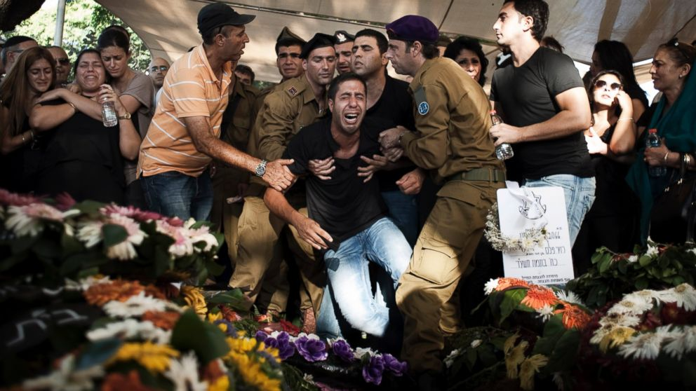 PHOTO: Family members of IDF Sergeant Daniel Kedmi react during his funeral at Kiryat Shaul cemetery on July 29, 2014. Kedmi was killed by a mortar shell close to the Gaza border.