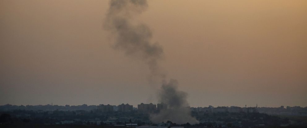PHOTO: Smoke rises following an Israeli strike on Gaza, seen from the Israel-Gaza border, Saturday, July 12, 2014.