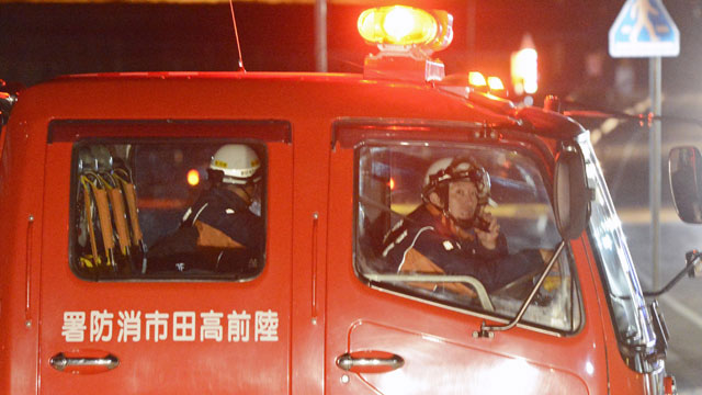 PHOTO: Firefighters in a fire fighting vehicle call for residents to evacuate from coastal areas in Rikuzentakata in Iwate Prefecture, Friday, Dec. 7, 2012, after a tsunami warning.