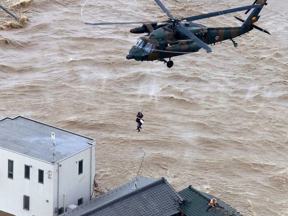 PHOTO: A resident is rescued from a flooded residential area in Joso, Ibaraki prefecture, northeast of Tokyo, Sept. 10, 2015.