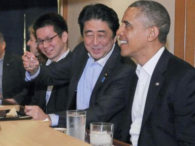 PHOTO: In this April 23, 2014 photo taken and released by Japans Cabinet Public Relations Office, Prime Minister Shinzo Abe, second right, shares a laugh with President Barack Obama as they have dinner at Sukiyabashi Jiro sushi restaurant in Tokyo.