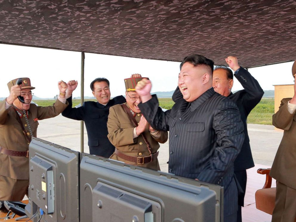 PHOTO: In this undated photo distributed on Sept. 16, 2017, by the North Korean government, leader Kim Jong Un, center, celebrates what was said to be the test launch of an intermediate range Hwasong-12 missile at an undisclosed location in North Korea.