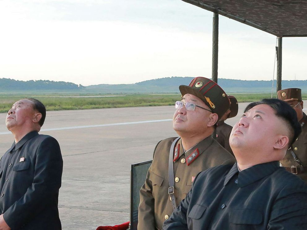 PHOTO: In this undated photo distributed on Sept. 16, 2017, by the North Korean government, leader Kim Jong Un, right, watches what was said to be the test launch of an intermediate range Hwasong-12 missile at an undisclosed location in North Korea.