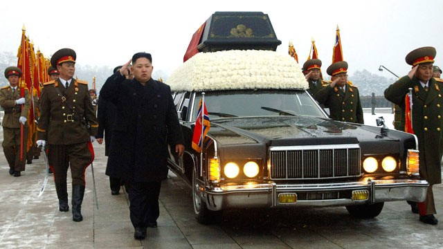 PHOTO: North Korea's next leader, Kim Jong Un, center, salutes as he walks beside the hearse carrying the body of his late father and North Korean leader Kim Jong Il during the funeral, in Pyongyang, North Korea, Dec. 28, 2011.