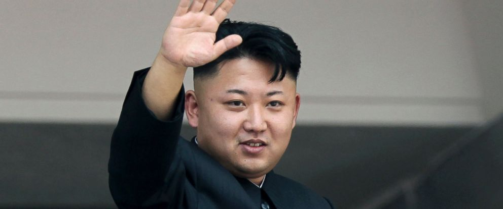 PHOTO: In this July 27, 2013 file photo, North Koreas leader Kim Jong Un waves to spectators and participants of a mass military parade celebrating the 60th anniversary of the Korean War armistice in Pyongyang, North Korea.
