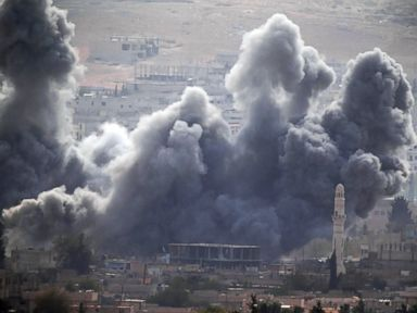PHOTO: Thick smoke rises following an airstrike by the US-led coalition in Kobani, Syria as fighting continued between Syrian Kurds and the militants of Islamic State group, as seen from Mursitpinar Turkey-Syria border, Oct. 13, 2014.