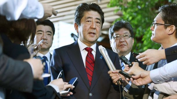 PHOTO: Japanese Prime Minister Shinzo Abe, center, answers to a reporter's question about North Korea's missile launch, at his official residence in Tokyo Monday morning, May 29, 2017.