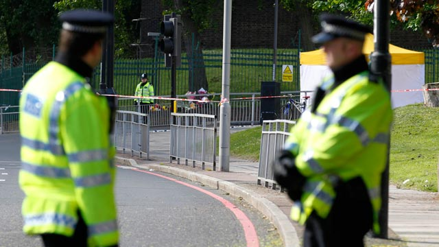 PHOTO: Police officers patrol the scene of a terror attack in Woolwich, southeast London, May 23, 2013.