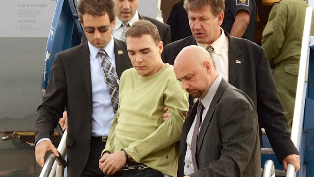 PHOTO: Luka Rocco Magnotta is taken by police from a Canadian military plane to a waiting van on Monday, June 18, 2012, in Mirabel, Quebec.