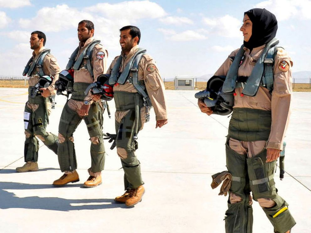 PHOTO: This June 13, 2013 photo provided by the Emirates News Agency, WAM, shows Mariam Al Mansouri, the first Emirati female fighter jet pilot, right, walking with other pilots at an undisclosed location in United Arab Emirates.