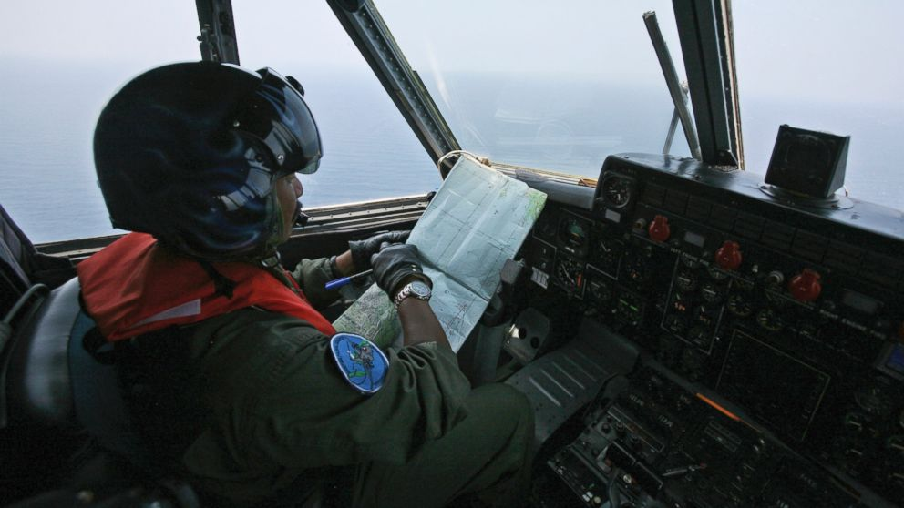PHOTO: An Indonesian Navy pilot checks his map during a search operation for the missing Malaysian Airlines Boeing 777 over the waters bordering Indonesia, Malaysia and Thailand near the Malacca straits on March 10, 2014.