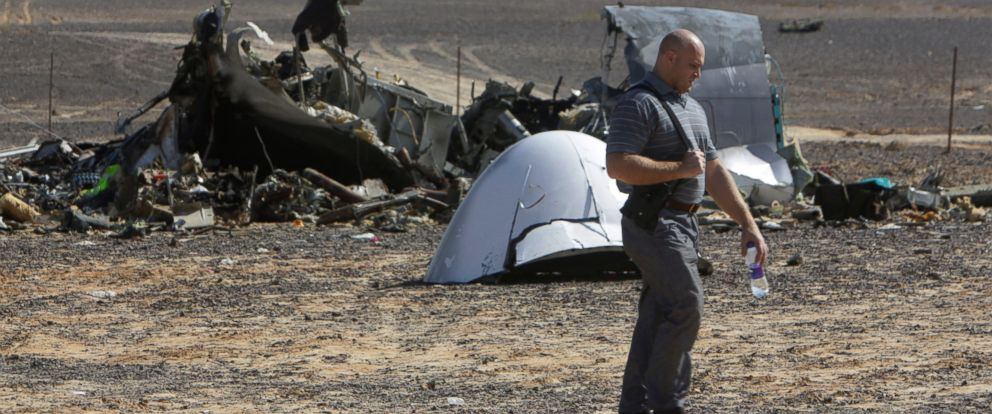 PHOTO: A Russian investigator walks near wreckage a day after a passenger jet bound for St. Petersburg, Russia, crashed in Hassana, Egypt, Nov. 1, 2015.
