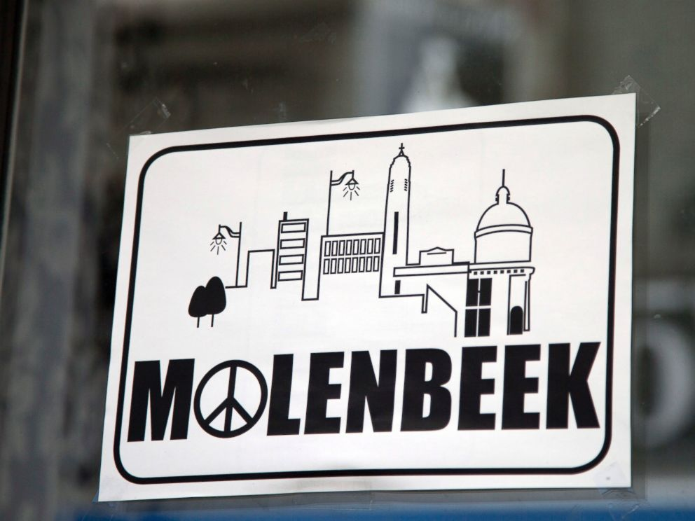 PHOTO: A sign in a shop window reads Molenbeek with a peace sign, on the main shopping street of Molenbeek, Belgium, Nov. 18, 2015.