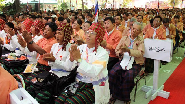 PHOTO: In this photo released from National League for Democracy (NLD), the party's representatives clap during one day advance meeting of their first ever party's congress at Royal Rose restaurant, March 8, 2013, in Yangon, Myanmar.