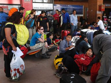 PHOTO: Foreign tourists and climbers wait for their flights at the Nepal International airport in Kathmandu, Nepal, April 27, 2015.