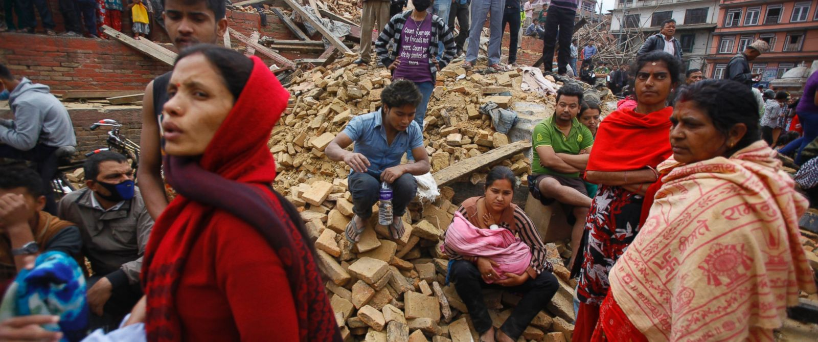 PHOTO: People rest on debris at Durbar Square after an earthquake in Kathmandu, Nepal, Saturday, April 25, 2015. A strong magnitude-7.9 earthquake shook Nepals capital and the Kathmandu Valley Saturday.