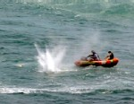 "PHOTO: Police in inflatable rubber boats shoot at a shark off Muriwai Beach near Auckland, New Zealand, Feb. 27, 2013, as they attempt to retrieve a body following a fatal shark attack. Police said a man was found dead in the water after being ""bitten by"