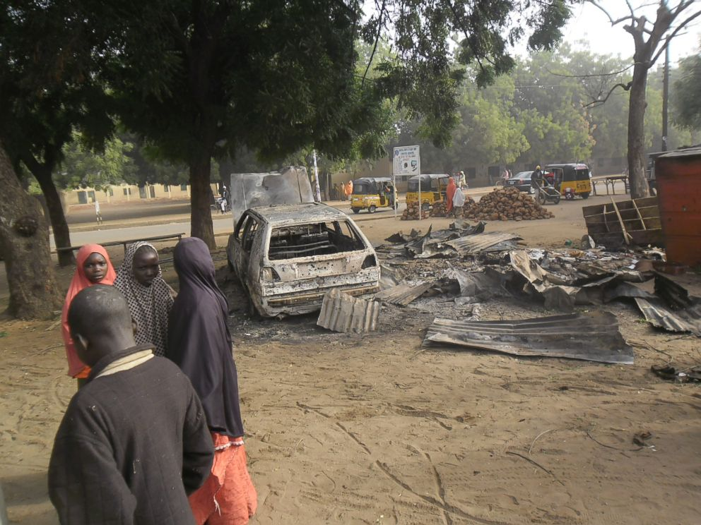 PHOTO: Children stand near the scene of an explosion in a mobile phone market in Potiskum, Nigeria, Jan. 12, 2015.