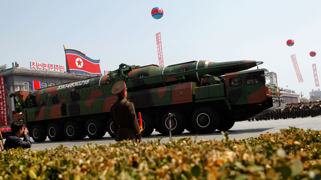 PHOTO: A North Korean vehicle carrying what appears to be a new missile passes b