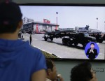 PHOTO: South Koreans watch TV news showing a footage of North Korean missiles on a military parade, at a Seoul Train Station in Seoul, South Korea, Saturday, May 18, 2013.