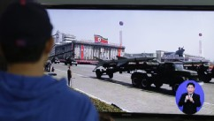 PHOTO:South Koreans watch TV news showing a footage of North Korean missiles on a military parade, at a Seoul Train Station in Seoul, South Korea, Saturday, May 18, 2013.