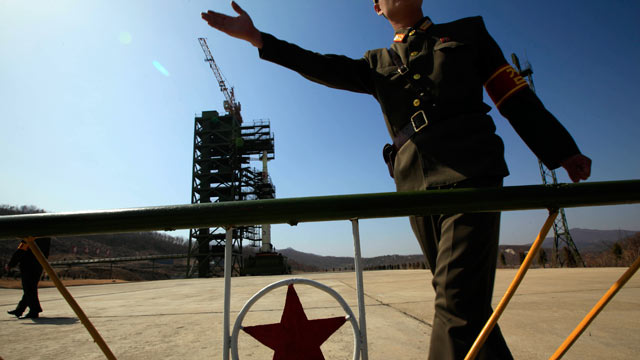PHOTO: A North Korean soldier stands in front of the countrys Unha-3 rocket, slated for liftoff between April 12-16, at Sohae Satellite Station in Tongchang-ri, North Korea, April 8, 2012.
