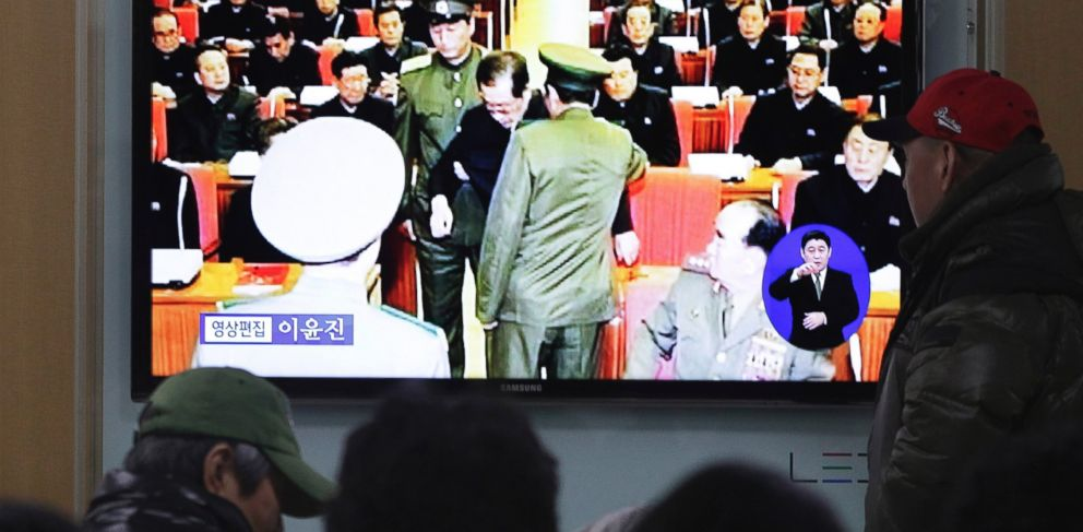PHOTO: People watch a TV news program at Seoul Railway Station, South Korea, Dec. 9, 2013 showing Jang Song Thaek, center, uncle of North Korean leader Kim Jong Un, being led out of a committee meeting.