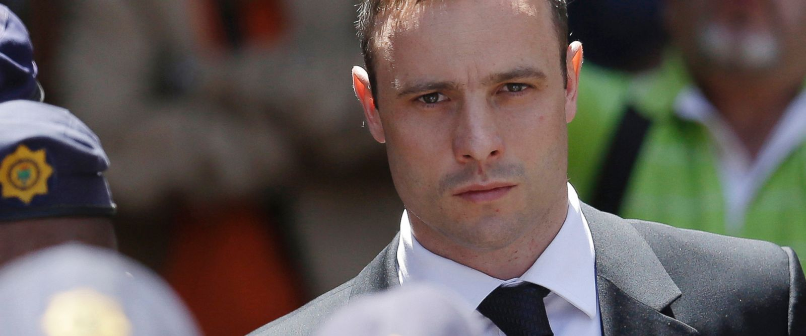 PHOTO: Oscar Pistorius is escorted by police officers as he leaves the high court in Pretoria, South Africa, Oct. 17, 2014.