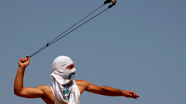 ap palestine rock wm nt 120928 wmain Today in Pictures: Palestinian Protester, Oktoberfest and Nepal Plane Crash