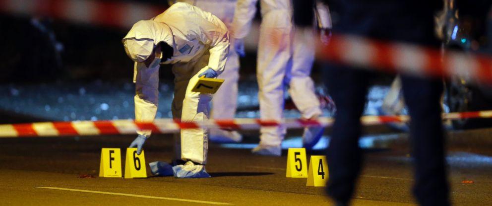 PHOTO: Investigators work outside the Stade de France stadium after a soccer match in Saint Denis, outside Paris, Nov. 13, 2015.
