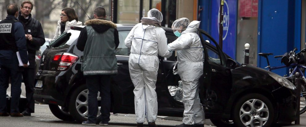 PHOTO: Forensic experts examine the car believed to have been used as the escape vehicle by gunmen who attacked the French satirical newspaper Charlie Hebdos office, in Paris, Jan. 7, 2015.