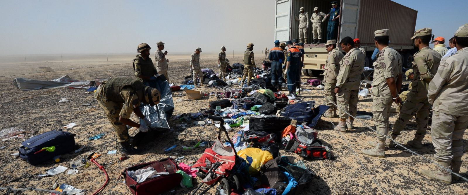 PHOTO: Egyptian soldiers collect personal belongings of plane crash victims at the crash site of a passenger plane bound for St. Petersburg in Russia that crashed in Hassana, Egypts Sinai Peninsula, Nov. 2, 2015.