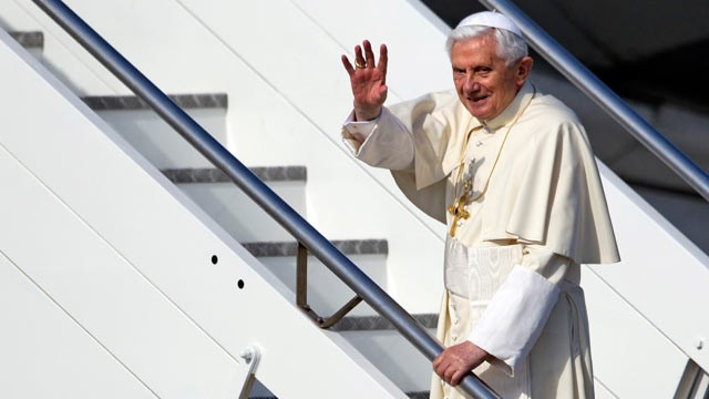 PHOTO: Pope Benedict XVI waves as he boards a plane on his way to a six-day visit to Mexico and Cuba, at Rome's Fiumicino international airport on March 23, 2012.