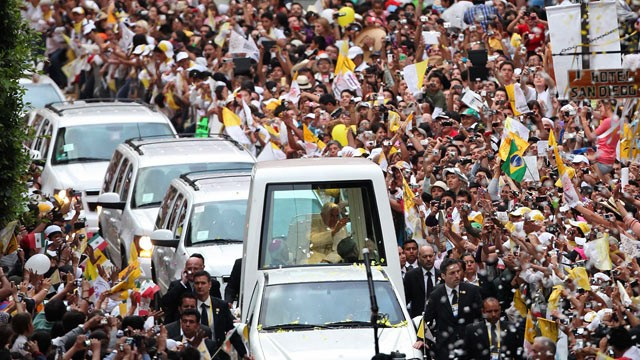 PHOTO: Pope Benedict XVI waves to faithful from his popemobile as he makes his way to Plaza de la Paz or Peace Plaza in Guanajuato, Mexico, Saturday, March 24, 2012.