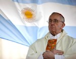 PHOTO: Argentinas Cardinal Jorge Bergoglio gives a Mass outside the San Cayetano church where an Argentine flag hangs behind in Buenos Aires, Aug. 7, 2009.