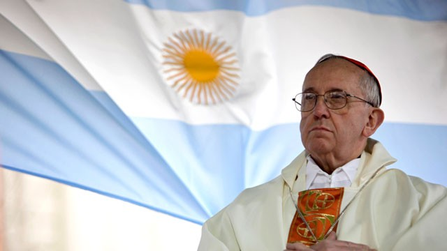 PHOTO: Argentina's Cardinal Jorge Bergoglio gives a Mass outside the San Cayetano church where an Argentine flag hangs behind in Buenos Aires, Aug. 7, 2009.