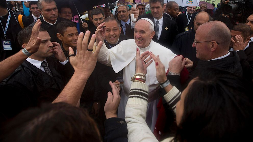 PHOTO: People greet Pope Francis, center, as he visits the Varginha slum in Rio de Janeiro, Brazil on July 25, 2013. Francis on Thursday visited one of Rio de Janeiros shantytowns, or favelas, a place that saw such rough violence in the past that its kn